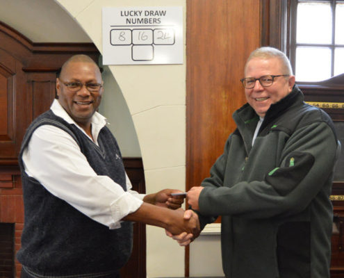 Advocate Bruce Dyke, lucky draw winner, with Kenneth, one of The Club's barmen. Kenneth always chooses the numbers for Bruce so Bruce shared the winnings with Kenneth.
